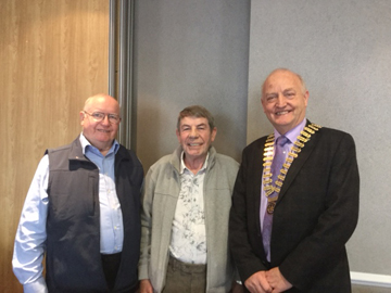 Past President Bob Baird and John Monaghan with President Henry