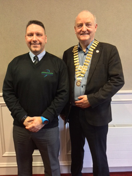 Ian Archer (Fermanagh Rural Community Transport) with President Henry